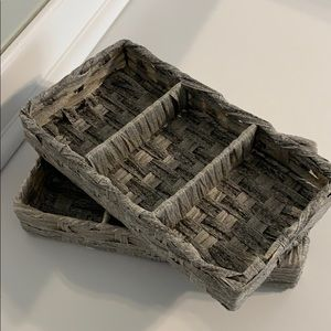 Two small wicker storage bins